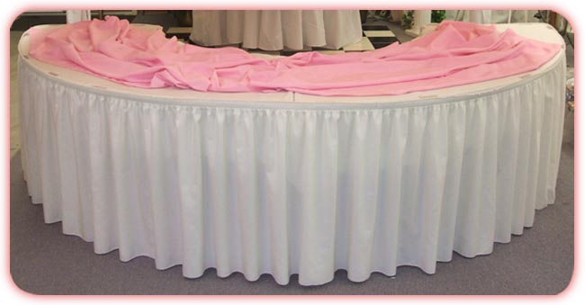 Curved tables with skirting